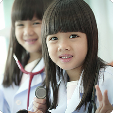 Two young Asian girls in hospital