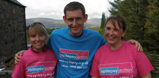 Three people in Epilepsy Action T-shirts